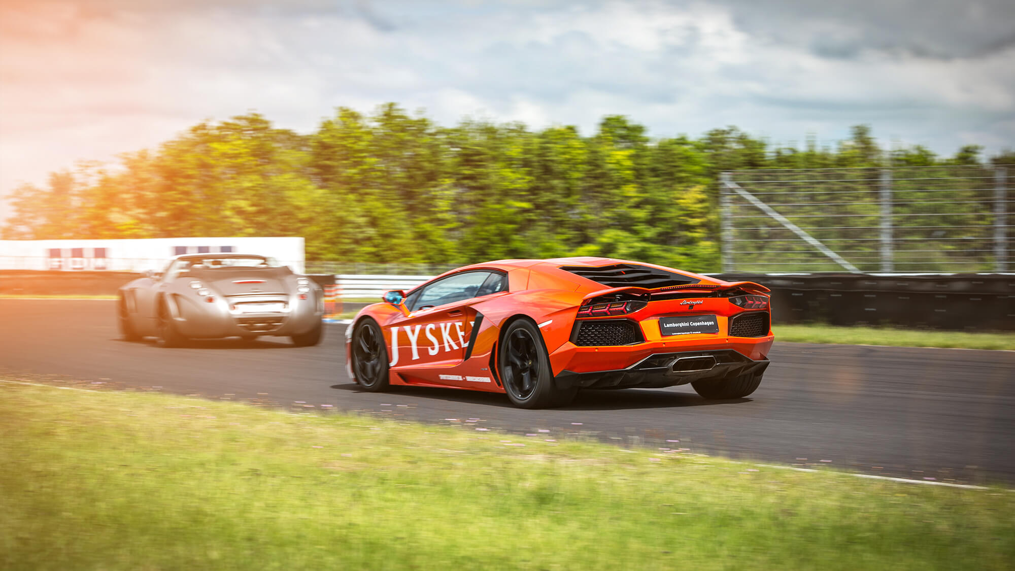 Orange Lamborghini Aventrador at Bornecancerfonden event - location Jyllandsringen in Denmark