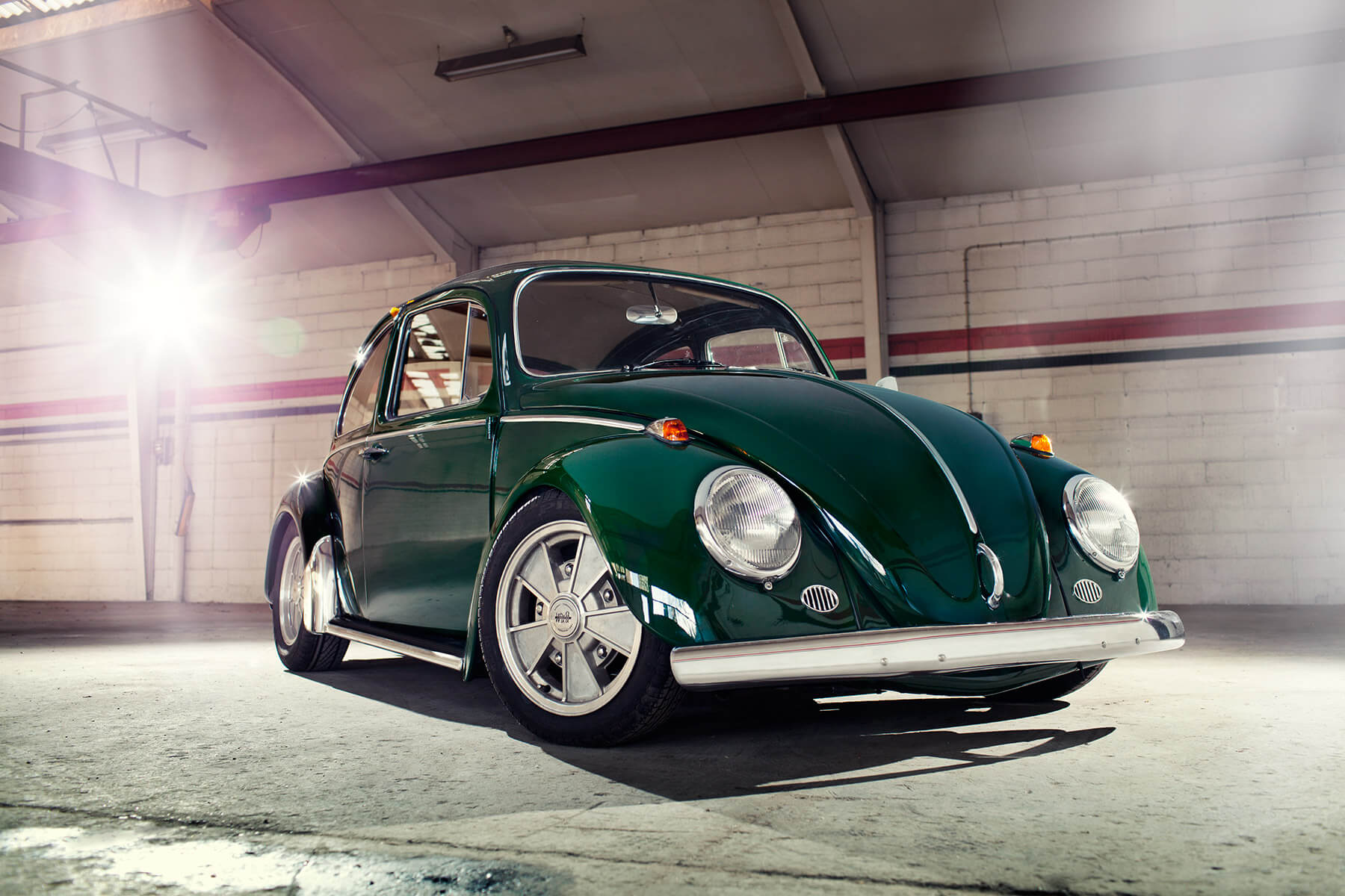 Classic retro Volkswagen Beetle in dark green front 02