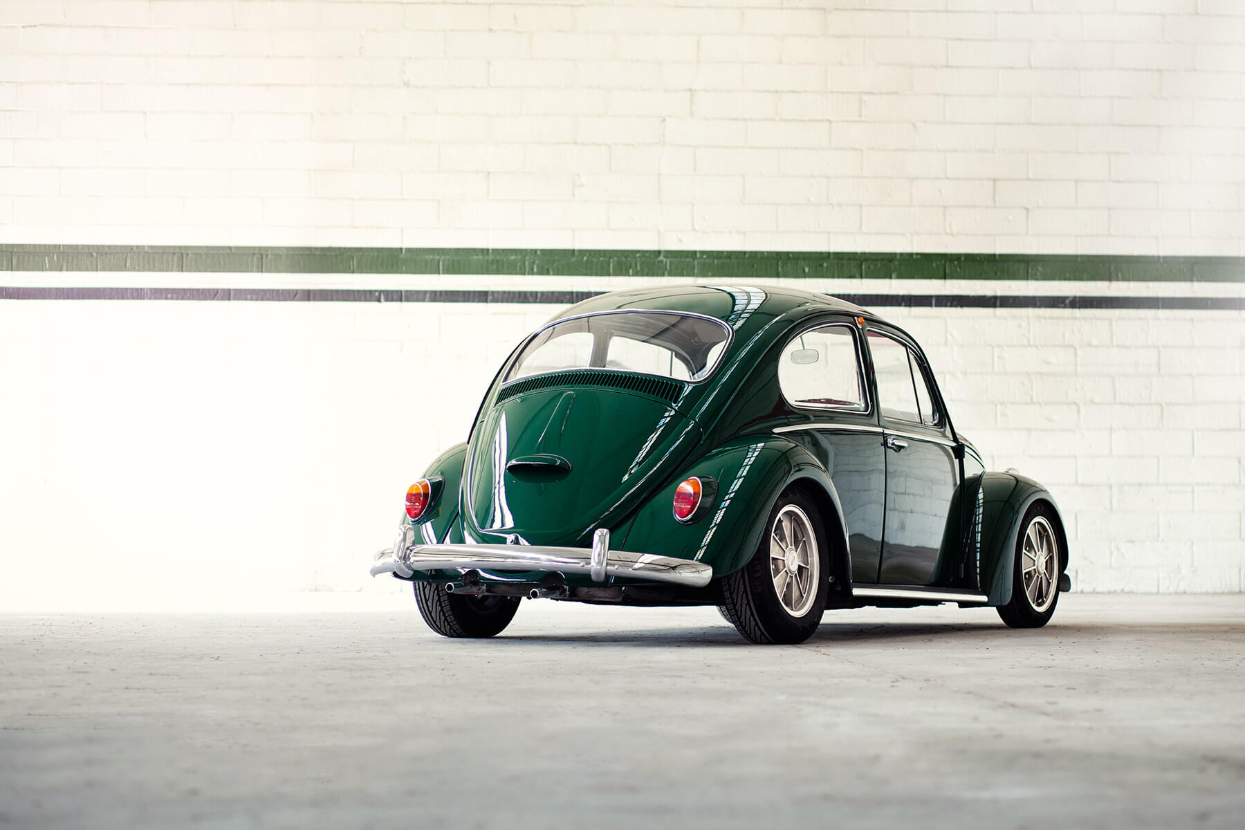 Classic retro Volkswagen Beetle in dark green rear 01